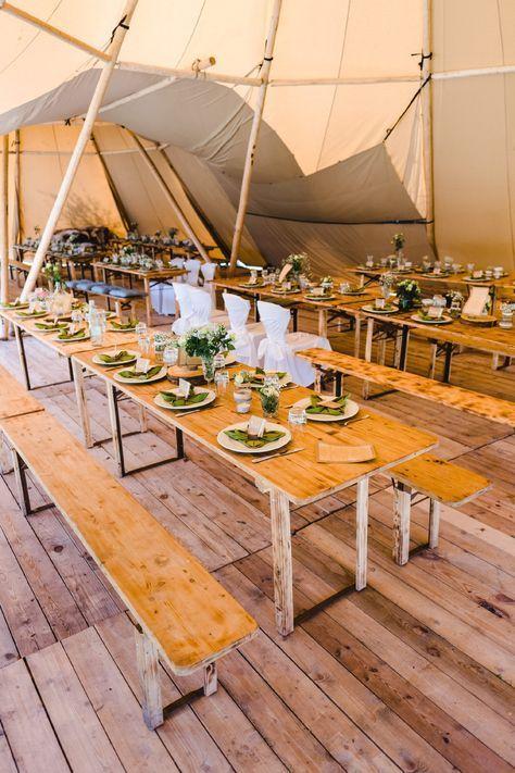 Eine Hochzeitsfeier / Hochzeit im Zelt mit Bierbank & Co. Foto: Stephan Presser Photography