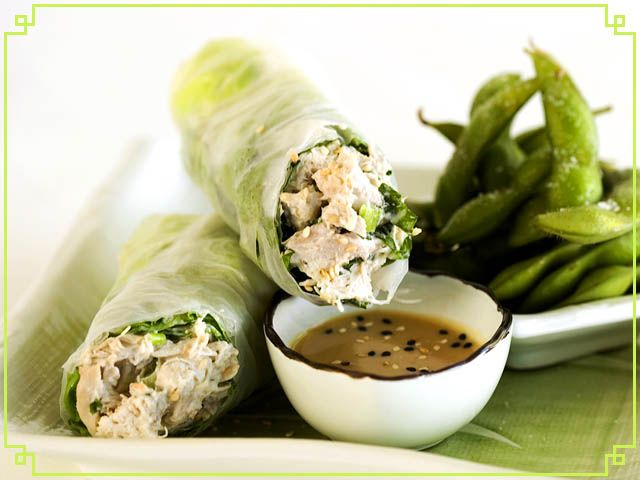 Sesame Chicken Salad wrapped in butter lettuce and rice wrapper served ...