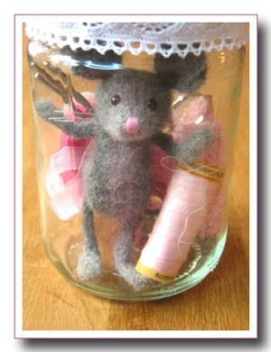 needle felted mouse is wonderful addition to sewing jar....(i want one of these bottled critters. CUTE!!)....