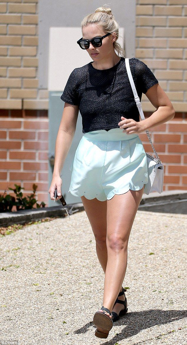 Off duty chic: Actress Margot Robbie, 25, was sighted cutting a low-key figure on Sunday as she attended a Gold Coast church with her grandfather