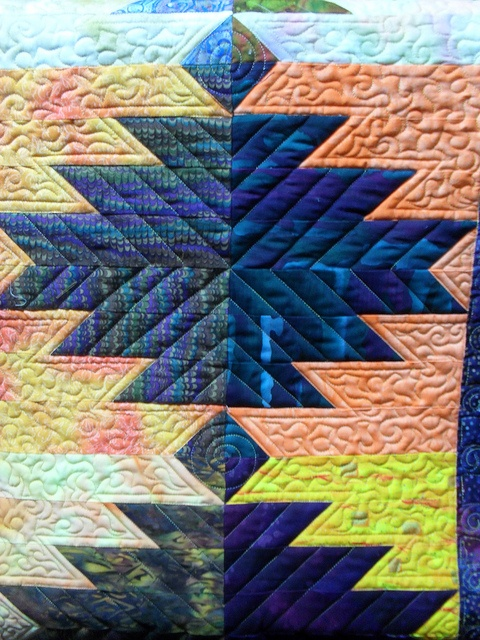 Southwestern-- I love how the diagonal quilting helps represent the design and, at the same time, camouflages how the block is made.