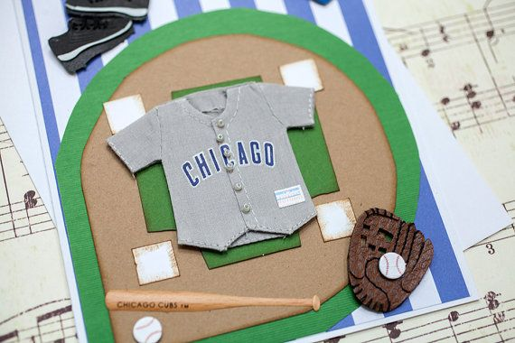 This Chicago Cubs birthday card is the perfect birthday greeting card to give to your favorite die hard Chicago Cubs fan! This card features a three dimensional Chicago Cubs jersey, Cubs baseball hat, baseball bat, baseball and catchers mitt layered on top of a baseball diamond and blue and white stripped paper. Happy Birthday is printed on front of the card. The inside of this baseball birthday card is left blank for your own heartfelt message. This handmade birthday card measures…