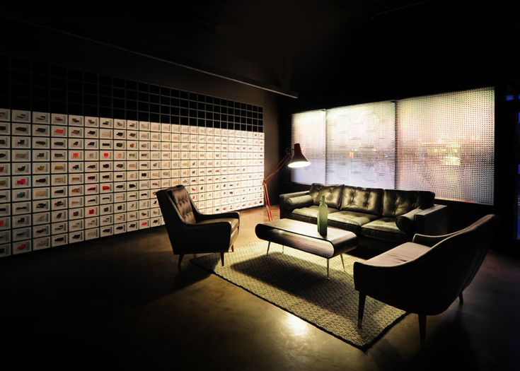 Furniture combines with digital projections in Made.com's new London showroom.