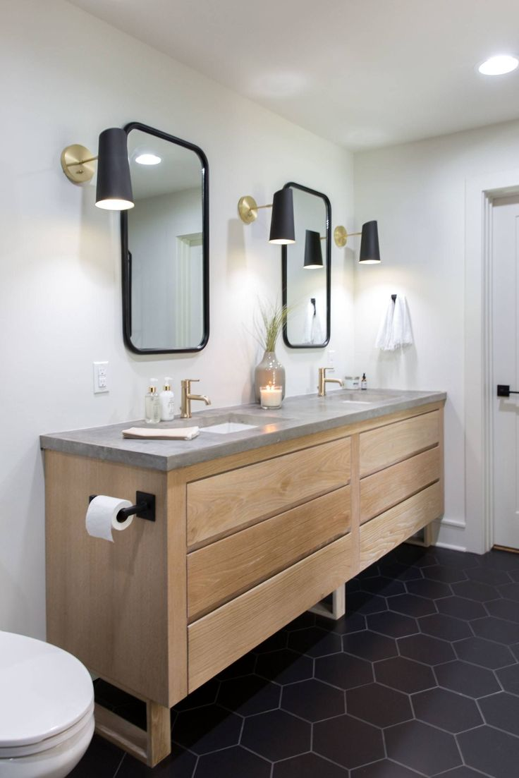 A spacious custom vanity with concrete countertops and two custom mirrors gives the Wixsoms their own individual areas to get dressed in the mornings.