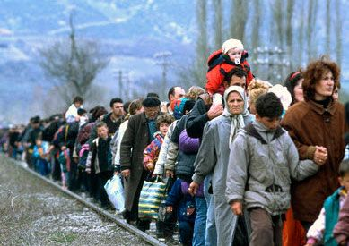 Kosovar refugees fleeing their homeland #WorldRefugeeDay