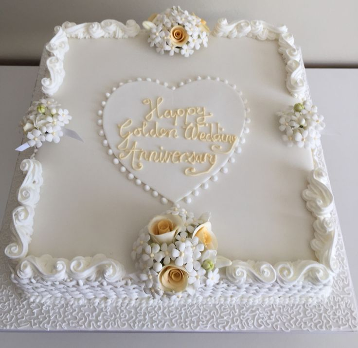 Golden wedding anniversary cake with Lambeth piping and sugar flowers. (Made with my sister)