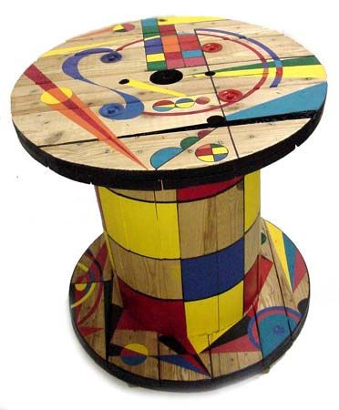 Turn an old cable reel into a side table.