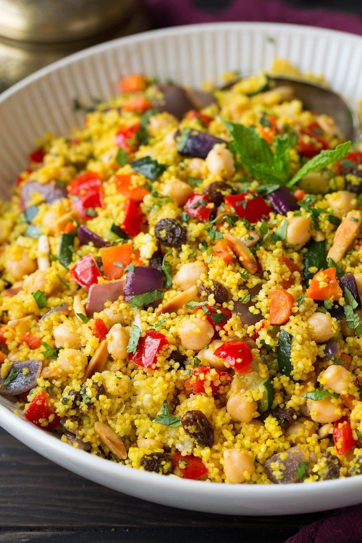 A flavorful, hearty Moroccan inspired, veggie packed couscous side dish that's perfect for summer meals! One of my new favorites!