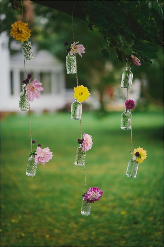 Unique flower decorations in glass bottles. Historic Manor, Outdoor Refined Wedding, Rustic Waterside Ceremony, Country Barn www.woodlawn-farm.com