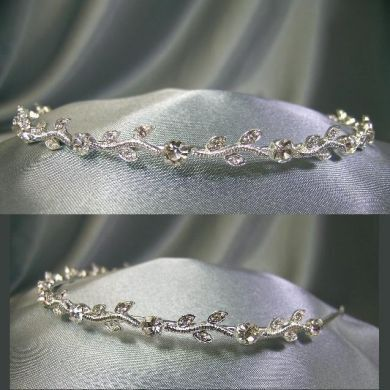 Elegant one row of leafs and Crystals Tiara For Pageant, Bridal, Veil, Wedding Gown This Tiara is made of beautiful first class clear rhinestones in silver tone. This Tiara is suitable for perfect bri
