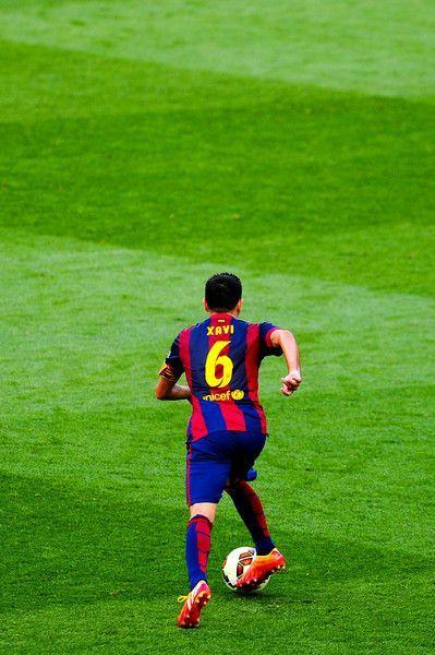 Xavi Hernandez of FC Barcelona runs with the ball during the La Liga match between FC Barcelona and RC Deportivo de la Coruna at Camp Nou on May 23, 2015 in Barcelona, Catalonia.