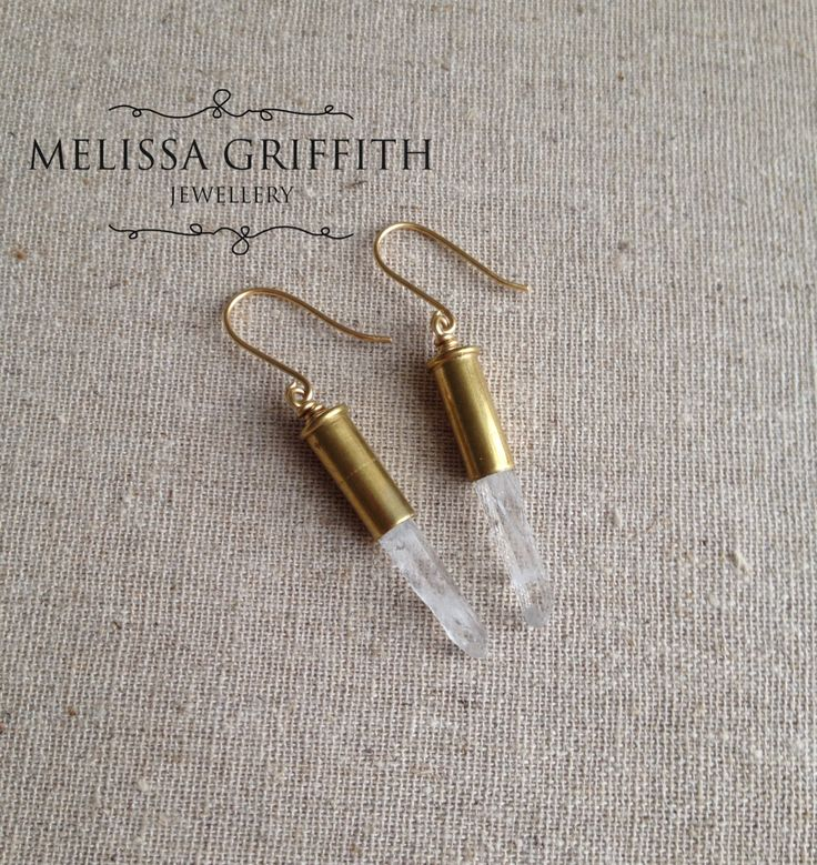 Raw Quartz Point Bullet Earrings (MGE86) $32.00 These unique earrings are made from reclaimed brass bullet casings with a raw crystal quartz point gemstone. These bullet earrings are edgy, but the touch of quartz refines them. They are extremely lightweight offering the wearer long time comfort. Earrings measure 2 inches from the top of brass earring hooks.