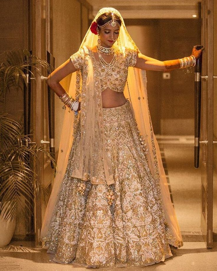 Bride Prachi Jain rocked a @rimple_harpreet_narula gold and ivory tulle lehenga like a diva. Tag a friend who'd rock this bridal look! #bridalportraits #ivory #RimpleAndHarpreetNarula #rimpleharpreetnarulalehenga #dreamy #lehenga #weddinglehenga #lehengagoals #bridallehenga #pheralook #wedding #bridallook #indianwedding #palacewedding #weddingsutra #traditional #bridalshoot #bridalmakeup #bridalhairstyle #desibride #designerlehenga #lehenga #indianbride