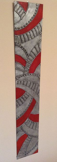 Hot Glue Gun Art - Spray painted with Metallic Silver, distressed with black paint and highlighted with a Red Glaze. by wylene