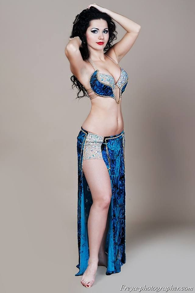 Bellydance costume. This is a very interesting blend of elements and takes my imagination in different directions. Side note: Photographers, please don't lead with the armpit front and center. It's tacky.