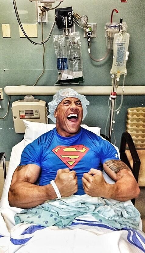 Wrestler turned actor, Dwayne 'The Rock' Johnson, in the recovery room after tearing his hernia during a wrestling match.