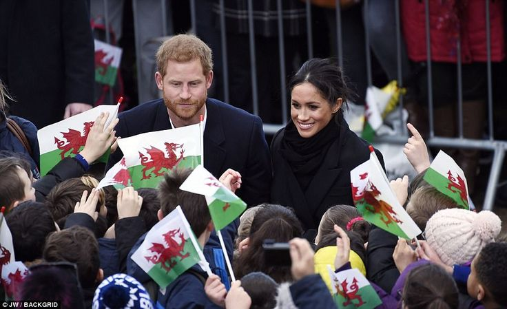 Cheering crowds shower Meghan and Harry with kisses, hugs and curtseys having waited all m...