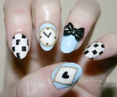 We think these Alice in Wonderland themed nails are great - featuring the clock, hearts playing card and bow tie...x