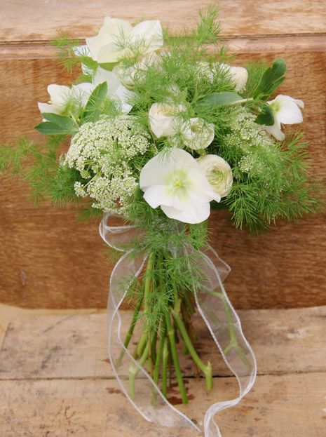 Delicate and pretty hand-tied white bridal bouquet with hellebores, on-trend hedgerow favourite ammi majus, ranunculus. This style of bouquet would be perfect for a boho wedding. Florissimo, Shropshire
