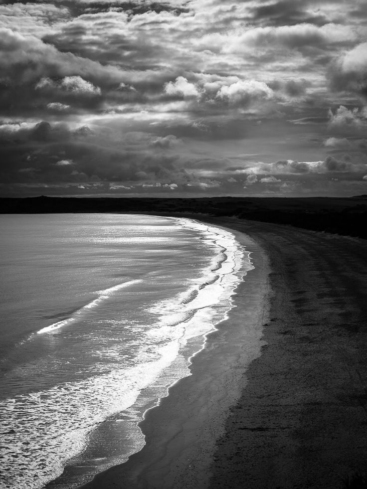Down by the curve of the bay...  6/7 in the nature challenge. Looking out along Tenby South Beach into the gathering clouds of a growing storm. They look almost too HDR but that's pretty much the black and white conversion as had to calm the sky down some. Liked the curving lines and pattern of contrasting curved shapes made in the sand as the tied receded.  #Olympus Em5MkII m.zuiko 12-40 f2.8 pro lens @ ISO 100 30mm f2.8 1/8000sec