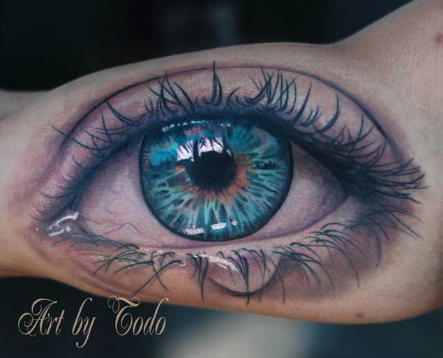Intricate Blue Eye Tattoo