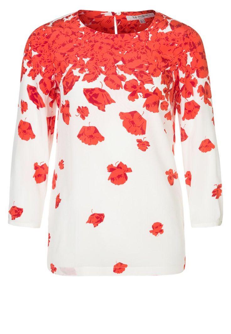 La blusa perfetta per le mezze stagioni? Floreale, con le foglie che cadono, ma rigorosamente arancione!   Blusa arancione - LK Bennet