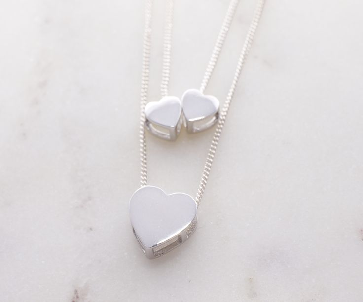 Mother daughter pendant. The two small hearts represent two daughters/children. Larger heart represents the mother. Meaningful sterling silver pendants.