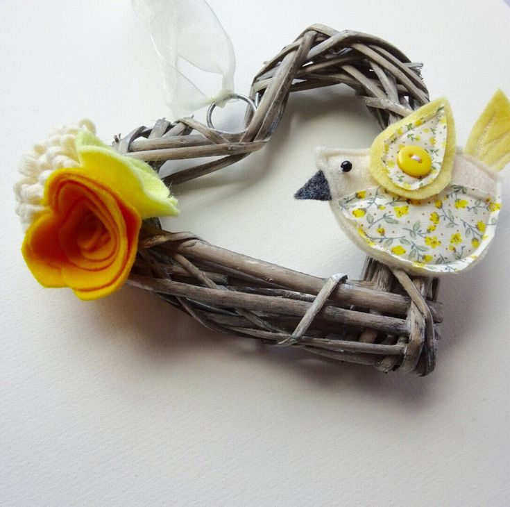 A personal favourite from my Etsy shop https://www.etsy.com/uk/listing/515803089/flower-wreath-yellow-bird-decoration
