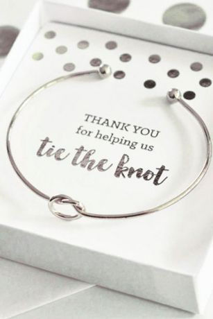 "These glamorous Tie the Knot Bracelets come packaged in a pretty heart gift box with a foil insert of your choice. Choose from ""Will you help us tie the knot"" or ""Thank you for helping us tie the knot"" in the foil color that matches the bracelet! Features and Facts: 18k Plated Gold or Silver. 2.75"" Diameter. Adjustable. White gift box and insert included."