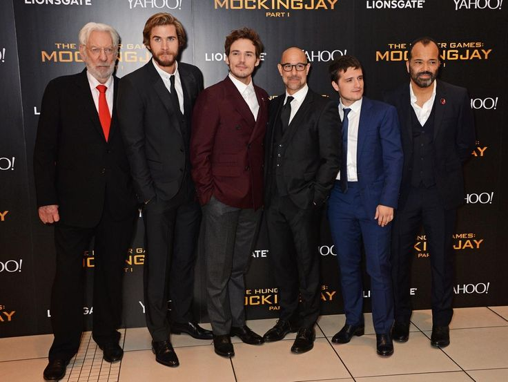 "The men of ""The Hunger Games,"" (lr) Donald Sutherland, Liam Hemsworth, Sam Claflin, Stanley Tucci, Josh Hutcherson and Jeffrey Wright lined up for pictures at Odeon Leicester Square in London."