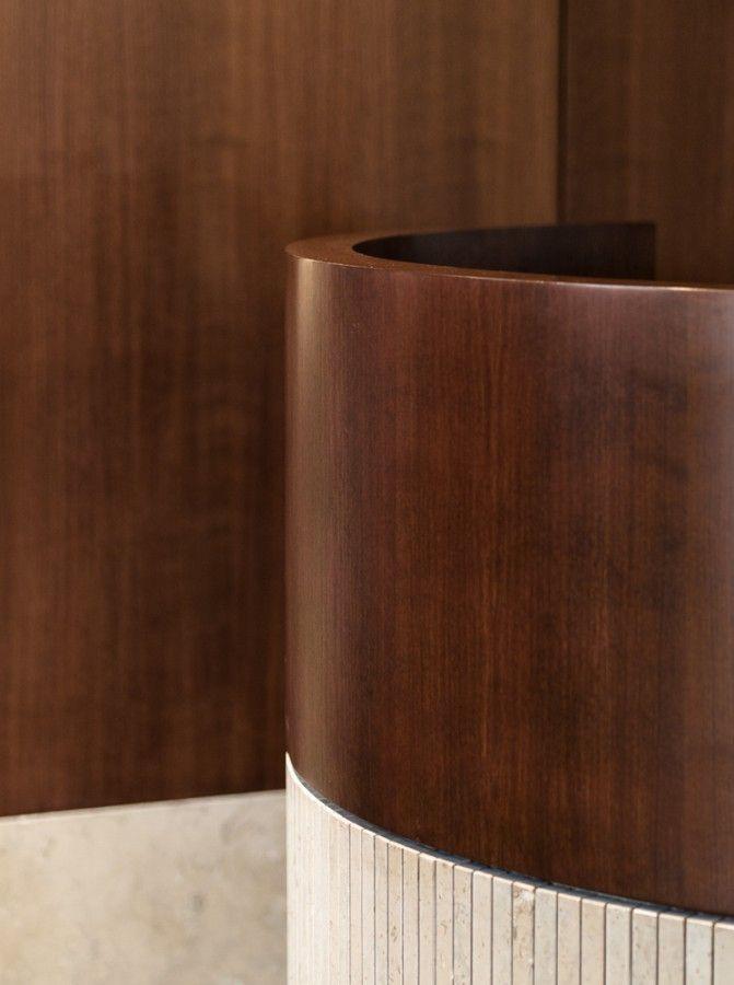 Dark wood + travertine marble.