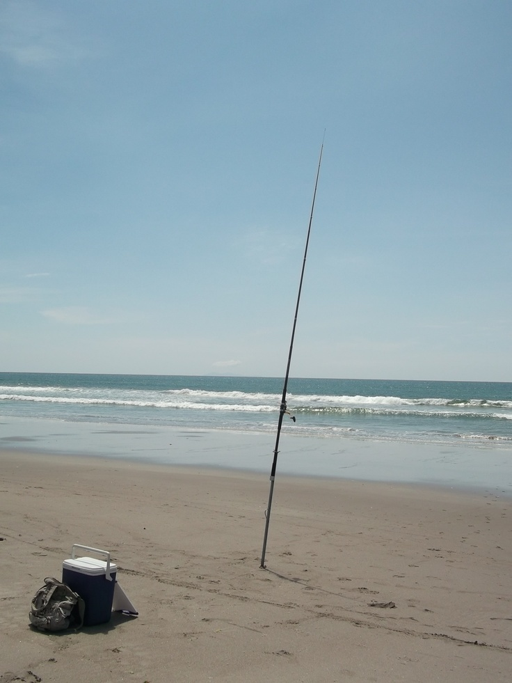 Fishing at Papamoa Beach, New Zealand