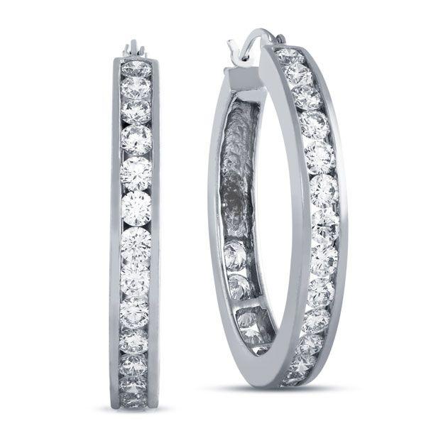 .79 carat total weight hoop earrings feature round cut diamonds channel set in 14k white gold. These hoop earrings measure 3/4 of an inch in diameter.