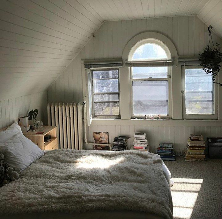 Attic reading nook with a big bed