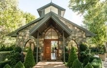 The exterior of Gold Creek Chapel makes charming backdrop for bridal party photos.