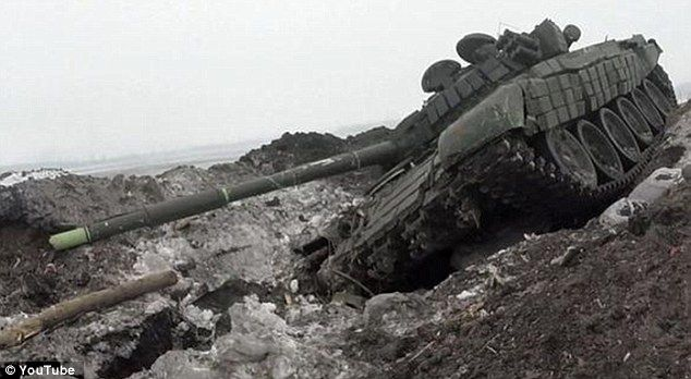 Here a Ukrainian tank lies damaged and unused in the battleground near Debaltseve. The Ukr...