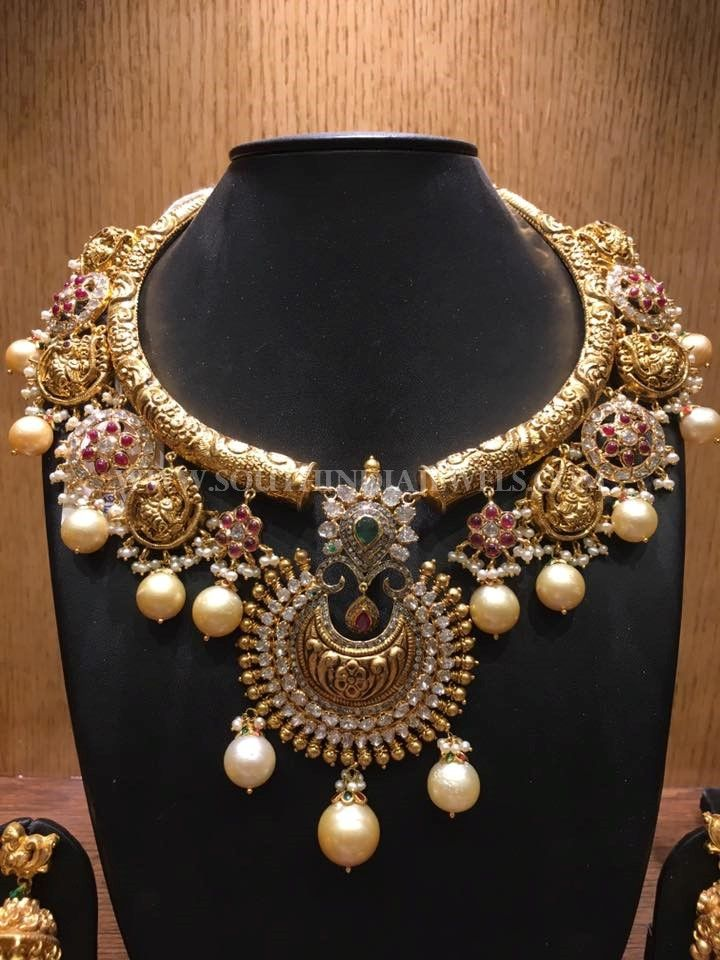 22k gold antique nakshi necklace studded with white stones, rubies and bold pearls. For inquiries please contact the seller below. Seller Name : Bhavani Jewellers Contact No : 9908194122 Whatsapp : 7799994438 Facebook : https://www.facebook.com/Bhavani-jewellers-308659449313839/ Related PostsAntique Lakshmi Necklace SetBeaded Necklace with Antique Pendant160 Grams Gold Neclace With Krishna PendantGold Antique Temple Necklace From BhimaGold …