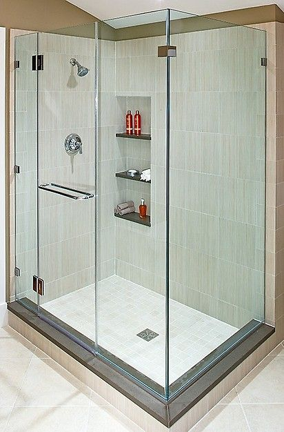 Love the cream colored tile and the shelved shower cubby for Bathroom design visit