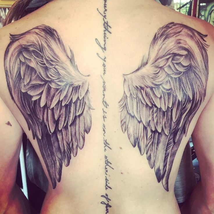 Angel wings, female back tattoo