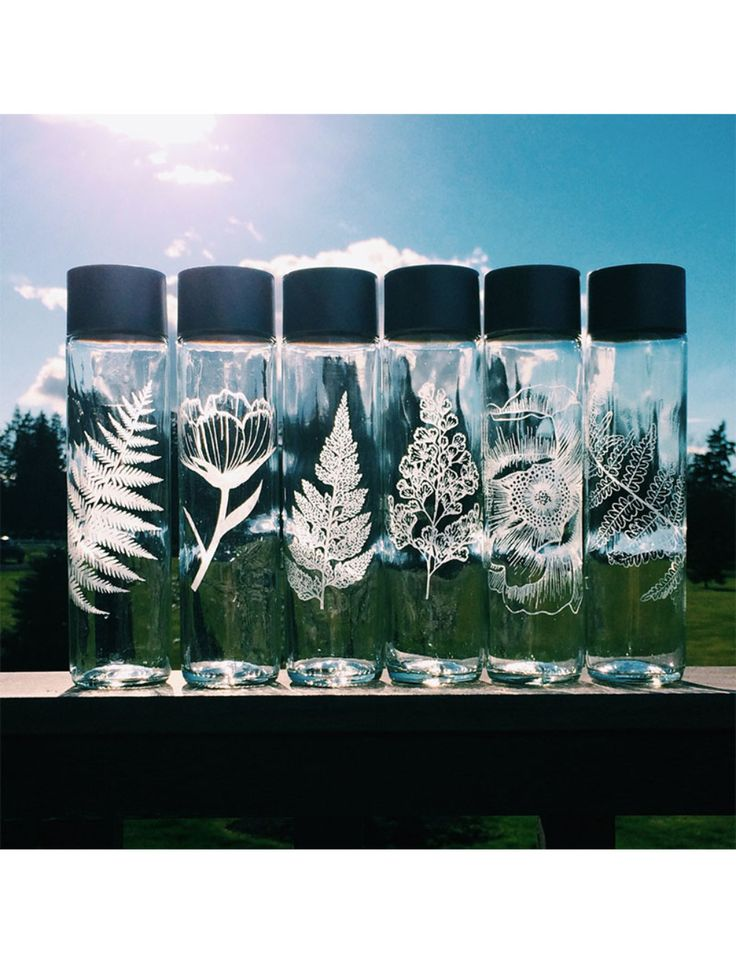beautifully etched glass water bottles from CrystalDaeDreams on Etsy
