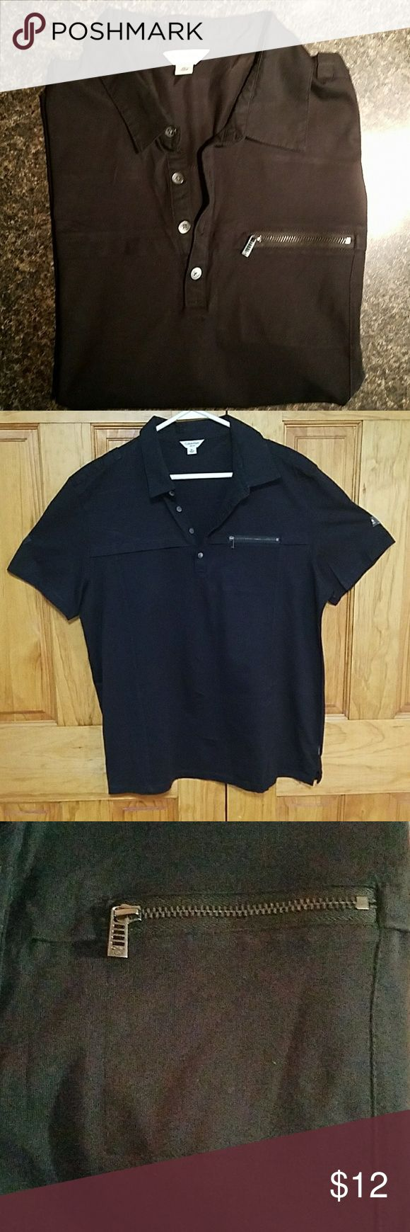 Calvin Klein Polo Great Calvin Klein shirt with a button up collar and zip pocket! Great condition, no marks or obvious wear!   Feel free to make an offer or bundle!! :) Calvin Klein Shirts Polos