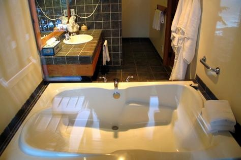 A double soaker tub sitting in a large picture window
