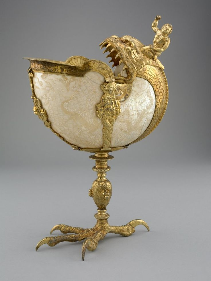 Standing cup; nautilus shell mounted in silver, gilt and chased; shell engraved with dragons among clouds; engraved band around lip, support...