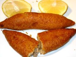 Koupes - My ALL time favourite snack in Cyprus,a meat filling with herbs coated in cracked wheat, deep fried and served with lemon to squeeze into and over it. You will find them in bakeries all over the island and in villages if someone has the time to make them Fabulous!!!