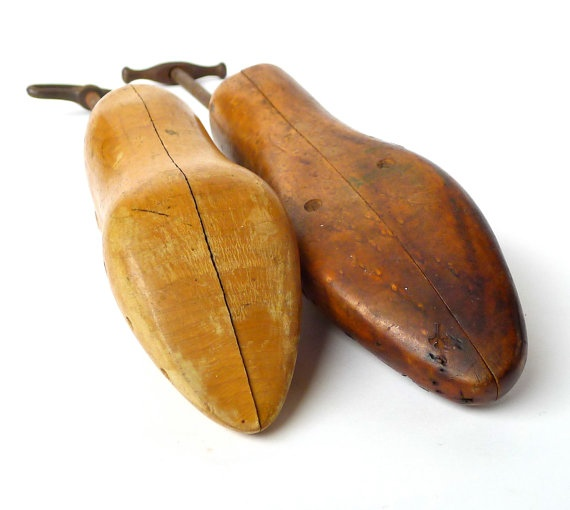 """Two vintage wood and iron shoe stretchers The darker wood form reads """"gladiator"""" on it and is 9-1/2"""" long. The blonder wood shoe form reads """"moving parts"""" and has the number """"1"""" stamped on it, and is 8-3/4"""" long. """"His and hers"""" pair perfect for the wedding couple, vignettes, to repurpose....etc."""