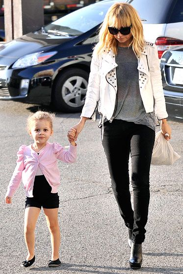 Nicole Richie w/ daughter rocking white leather jacket, grey tee, and black skinnies. cute :)---her peanut looks pretty darn cute too!
