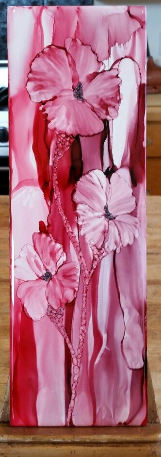 Flowers in alcohol ink on 12x4 tile with blended back ground by Tina