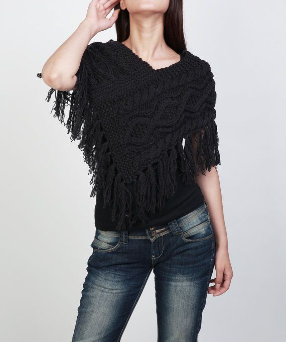 It is a beautiful hand knit charcoal poncho/ capelet, and also you can wear it as chunky neck warmer/ tube scarf. It is made of 60% wool/ 40% acrylic