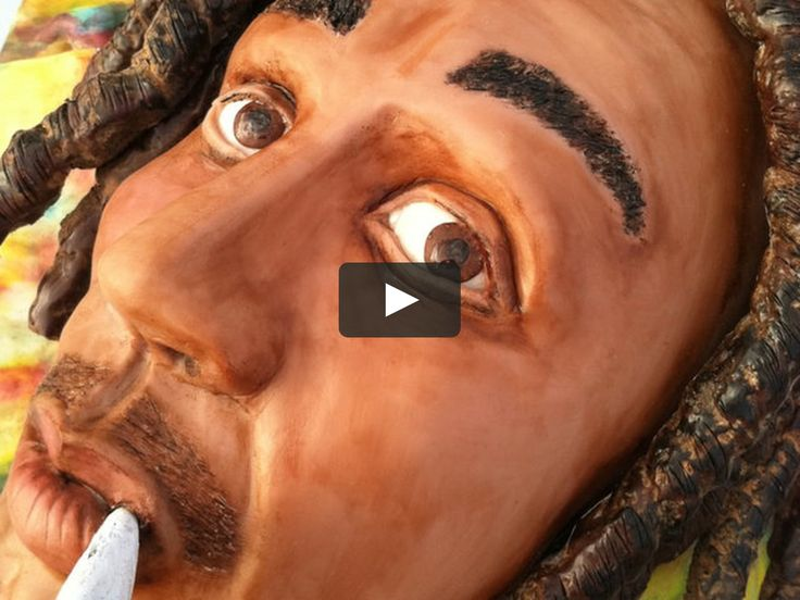 This is an entirely edible Bob Marley cake sculpture.  He is made with cake, crispy treats, chocolate, and sugar paste.  Let Them Eat Cake.....And Art!