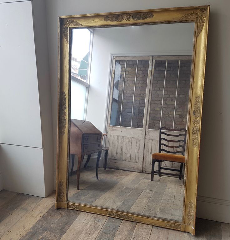 A fabulous nineteenth century gilt mirror retaining its original glass plate. looks great as a full length floor mirror or as an overmantel.